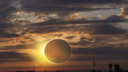 Scientific natural phenomenon . Total solar eclipse with diamond ring effect glowing on sky . Serenity nature background .