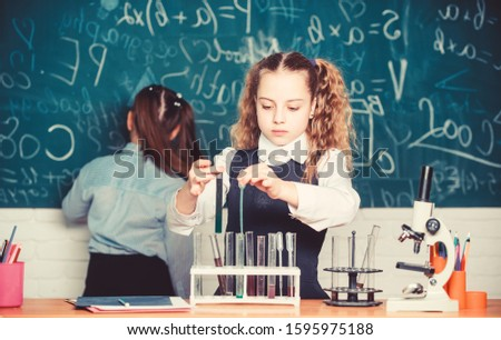 Scientific researches. childrens day. Chemistry. Back to school. Little children at school lesson. Little kids learning chemistry in school lab. students doing biology experiments with microscope.