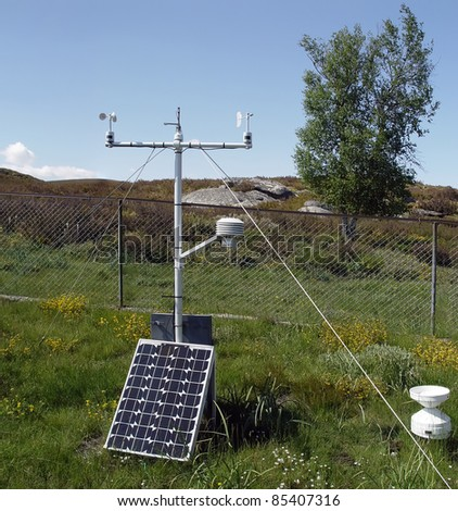 Scientific weather station with solar panel attached.