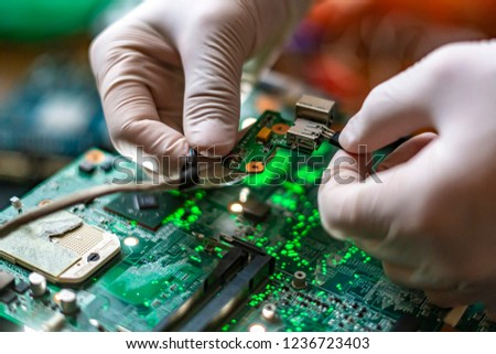 scientist assemble the modern technology gadget pieces in the laboratory