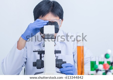 Scientist check an analysis sample in laboratory room.