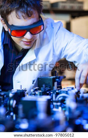 scientist doing research in a quantum optics  lab (shallow DOF; color toned image)