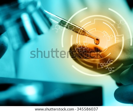 Scientist  dropping chemical liquid to microscope with chemical equations , Laboratory research concept