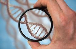Scientist examines DNA molecule. Genetics research concept.