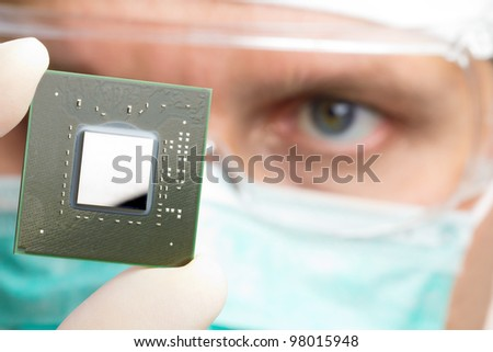 Scientist examining a microchip