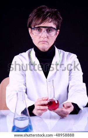 Scientist holding flask with red fluid