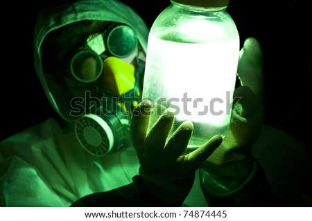 scientist holding glowing toxic substance