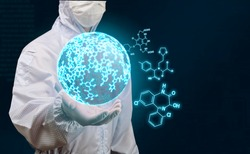 scientist holding sphere of glow chemical formula