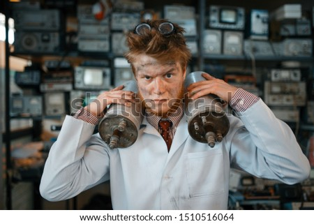 Scientist holds radiation devices in his hands #1510516064