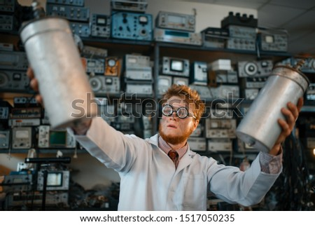 Scientist holds radiation devices in his hands #1517050235