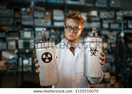 Scientist holds radiation materials in his hands #1510516070