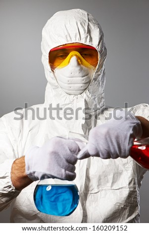 scientist in protective wear ...