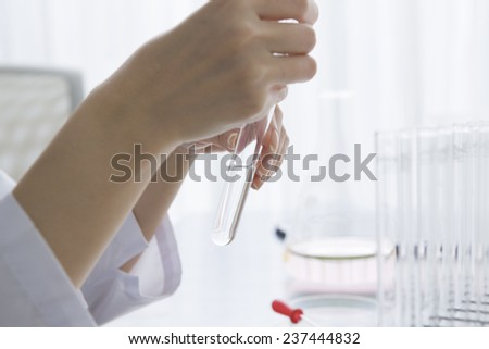 Scientist is checking the medicine in the test tube