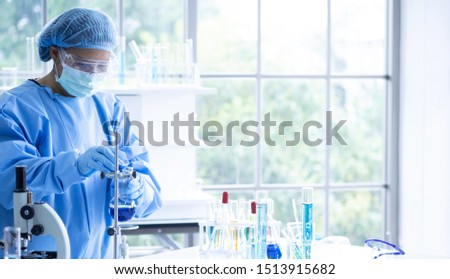 Scientist research, analyze chemistry formulas, biological test results, Professor discovered a new formula for treating disease in laboratory.