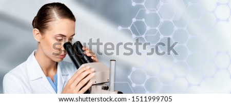 Scientist researcher using microscope in laboratory. Medical healthcare technology and pharmaceutical research and development concept.