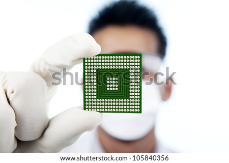 Scientist showing a microchip computer, shot in studio