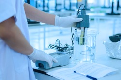scientist used chemical solution and lab testing for water quality or ph meter in laboratory ,research and science concept
