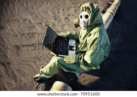 Scientist with laptop in zone of ecological disaster