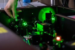 scientist work with laser machine or system