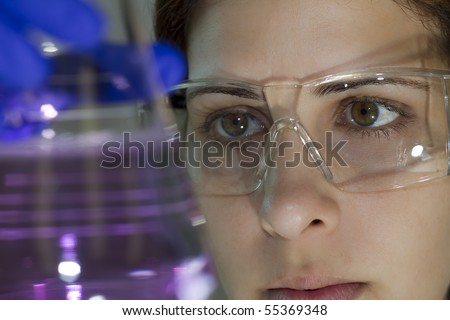 scientist working in her laboratory examining an experiment