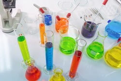 Scientist working on colorful test tube to analysis and develop vaccine of covid-19 virus in lab or laboratory in technology medical, chemistry, healthcare, research concept. Experimental science test