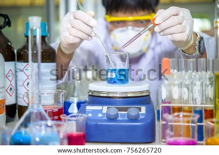 Scientists are boiling and stirring chemicals on the machine hotplate stirrer. In the chemistry laboratory. #756265720
