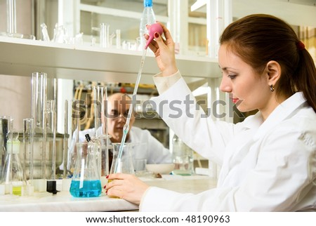 scientists conducting research in the chemical laboratory
