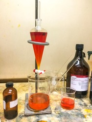 Scientists extracted Bromine Br2 and a chemical odor and corrosion in a fume hood in a chemistry laboratory of Southeast Asia.