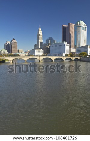 Scioto River and Columbus Ohio skyline in autumn, with setting sunlight