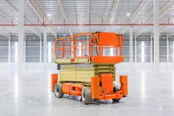 Scissor Lift Aerial Work Platform at a construction site.