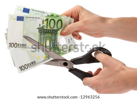 Scissors and euro. - stock photo
