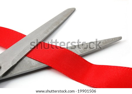 scissors and red ribbon isolated on white showing a ceremonial opening