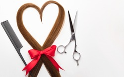 Scissors, comb and heart shaped hair lock. Professional barber hair cutting shears on white background. Hairdresser salon equipment, premium hairdressing set. Accessories for haircut. Valentines day.