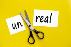scissors cut the word unreal. concept believable. cuts the word un. I can, goal achievement, potential, real, overcoming. unreal is believable.