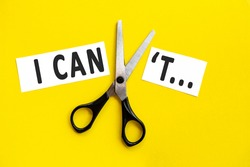 scissors cut the words i can not. concept believable. cuts the word un. I can, goal achievement, possible, potential, real overcoming. unpossible is believable.