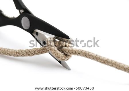Scissors cutting a knot ? a problem solving concept