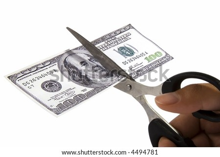 Scissors cutting an one hundred dollar note.