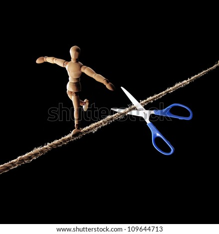 scissors cutting the rope to a tightrope walker.
