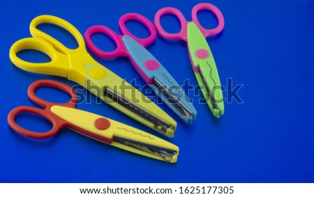 Scissors for scrapbooking on a blue background