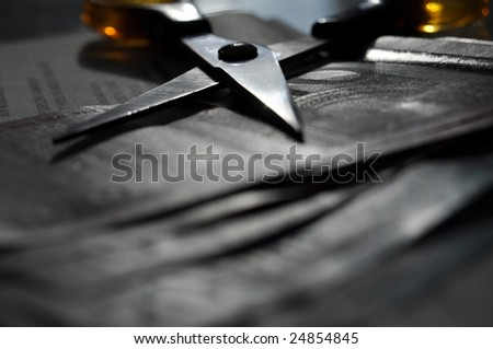 Scissors on money (cutting costs concept)