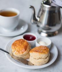 scone set with strawberry jam,cream cheese and hot tea