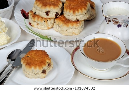 Scones with strawberry jam and clotted cream.