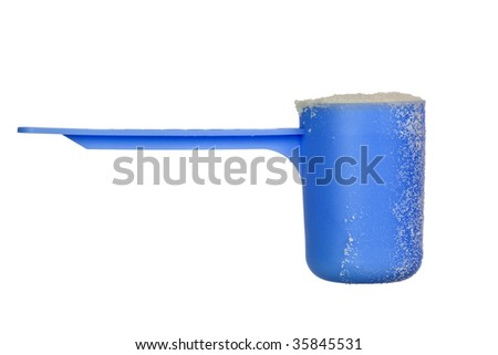Scoop of baby milk powder isolated on white background