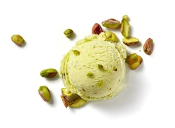 Scoop of pistachio ice cream with pistachio nuts on white background. Top view of ice cream isolated for package design of pistachio ice cream.