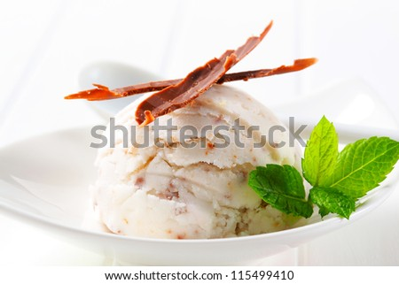 Scoop of stracciatella ice cream on a plate