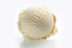 Scoop of vanilla ice cream close-up isolated on white background