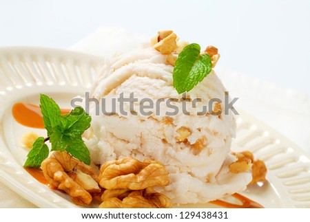 Scoop of walnut ice cream with caramel sauce