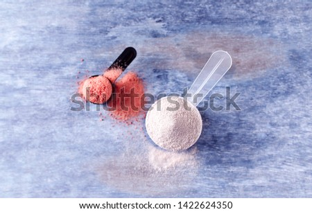 Scoop of Whey Protein and Creatine Powder. Sport nutrition. Rustic wooden background. Top view. Copy space