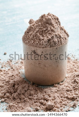 Scoop of Whey Protein in background. Sport nutrition.