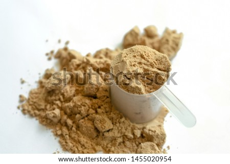 Scoop of whey protein with isolated white background.